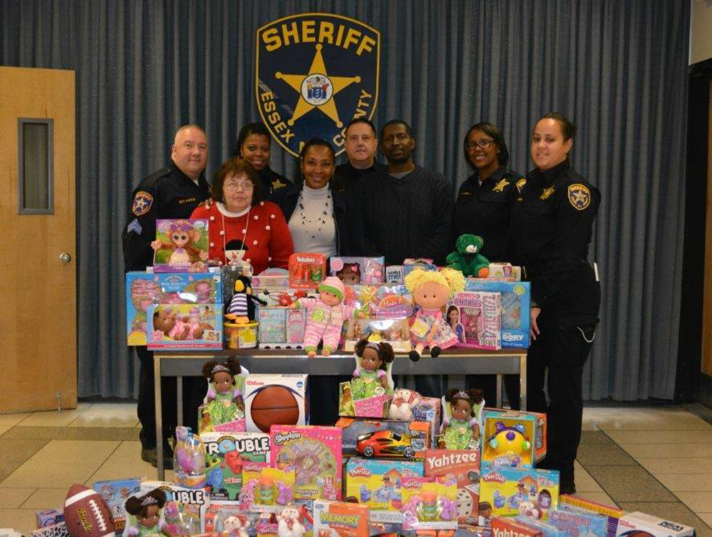 Protect and serve: The Essex County Sheriff's Office donated sports equipment, board games, dolls and stuffed animals to the New Community Family Resource Success Center during the holiday season.  Many thanks to Sheriff Armando Fontoura and his staff for holding a toy drive that provided gifts to many families in need in the greater Newark area this holiday season. The Family Resource Success Center is a one-stop center that connects individuals to resources within the NCC network as well as to outside agencies. The center's new location is 274 South Orange Ave. in Newark. For more information, call the center at 973-565-9500. Photo courtesy of Kevin Lynch.