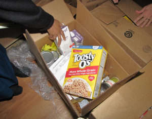 Food boxes for seniors: The Community FoodBank of New Jersey's Commodity Supplemental Food Program (CSFP) recently began distributing boxes filled with primarily nonperishable goods to eligible seniors at New Community Gardens Senior.