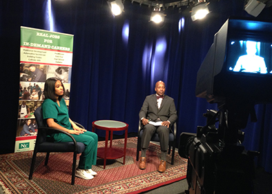 Ayannah Thomas, left, a student in the Certified Medical Assistant Program, talks about her career goals with Rodney Brutton, director of Workforce Development, on Episode 2.