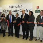 CEO Richard Rohrman, fourth from left, at the ribbon cutting of NCC's new Financial Opportunity Center in February.