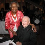Madge Wilson, left, board member and outreach coordinator, and Monsignor William J. Linder at his 80th birthday celebration in June.