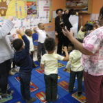 Donna Holmes, standing center, a professional actress and playwright, infuses creativity into lessons at Community Hills Early Learning Center as part of the New Jersey Performing Arts Center's Early Learning Through the Arts program.
