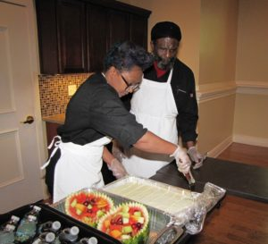 Culinary Arts Specialist students catered the lunch, which featured fried chicken, fish, curry chicken, side dishes and dessert.