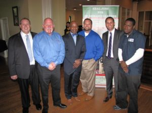 Director of Workforce Development Rodney Brutton, third from left, with employer partners and an automotive student, far right, at the anniversary event.