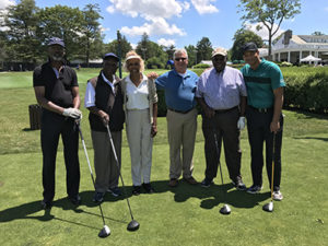 Golf Outing Co-Chair and NCC Board Member Dr. A. Zachary Yamba, second from left, with his foursome and NCC Outreach Coordinator and Board Member Madge Wilson and NCC CEO Richard Rohrman, center.