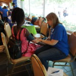 While children shopped, parents participated in health screenings, including getting their blood pressure checked.