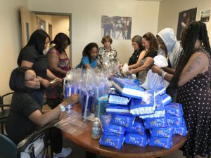 SAIF associates help members of the NCJW/Essex Period.Project bag up feminine hygiene products for distribution. The women shared their experiences with the products and the challenges they have faced without access to them.