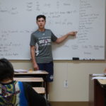 Liam Brown helps teach an English class at the New Community Adult Learning Center.