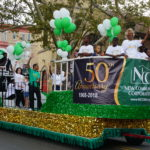 Parade grand marshals Madge Wilson, NCC Outreach Coordinator, and DJ Lilman on the lead float.