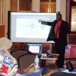 Guest speaker Dwayne Scott provides information about personal finances to the students.