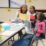 Harmony House Youth Counselor Marcia Ramos works with children as part of the Excel after-school program.