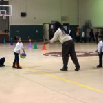 Owner of Video Life Productions John Pallone captures students in the after-school program at the NCC Neighborhood Center playing kickball.