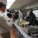Owner of Video Life Productions, John Pallone, gets footage of a New Community Workforce Development Center Culinary Arts Specialist student in the commercial kitchen.