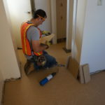 Flooring work in a unit of Douglas Homes.