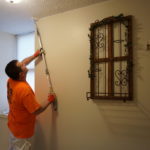The ceiling of a Roseville Senior apartments gets painted.