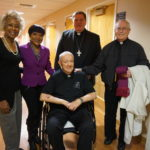 New Community Board Member and Outreach Coordinator Madge Wilson, Extended Care Administrator and Director of Health and Social Services Veronica Onwunaka, NCC Founder Monsignor William J. Linder, Cardinal Joseph W. Tobin and Father Philip Waters, left to right, during the cardinal's visit to Extended Care.
