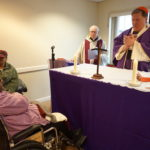 Cardinal Joseph W. Tobin, the Archbishop of Newark, right, leads mass at the Extended Care chapel.