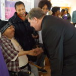 Cardinal Joseph W. Tobin, the Archbishop of Newark, meets a resident of New Community Extended Care.
