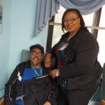 Extended Care Director of Nursing Debbie Ogendele gives resident Randy Curry a shirt during Adopt-A-Resident Day.