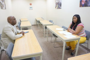 Newark 2020 participant Bernard McAllister, left, meets with New Community Workforce Development Center Program Assistant Quameria Edwards regarding his job interests and his resume during the orientation held at the site May 14.