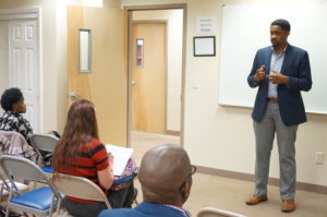 Newark 2020 Project Director Travis Reid explains the initiative to participants during the orientation at New Community Workforce Development Center May 14.