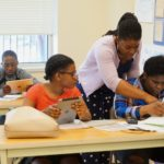 Lead Academic Enrichment Instructor Odette Phillip provides guidance to her students during the introduction to coding May 9.