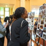 Those who attended the repast for Monsignor William J. Linder look at photos of him throughout his life. The repast was held June 16 at St. Joseph Plaza.