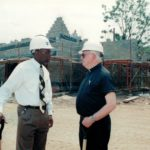 Monsignor in Front of Construction