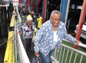 Grace Freeman, front, a New Community Manor Senior resident, and her friend, Jean Lightfoot, behind on ramp, boarded the Spirit of New York cruise ship at Chelsea Har- bor Pier 61.