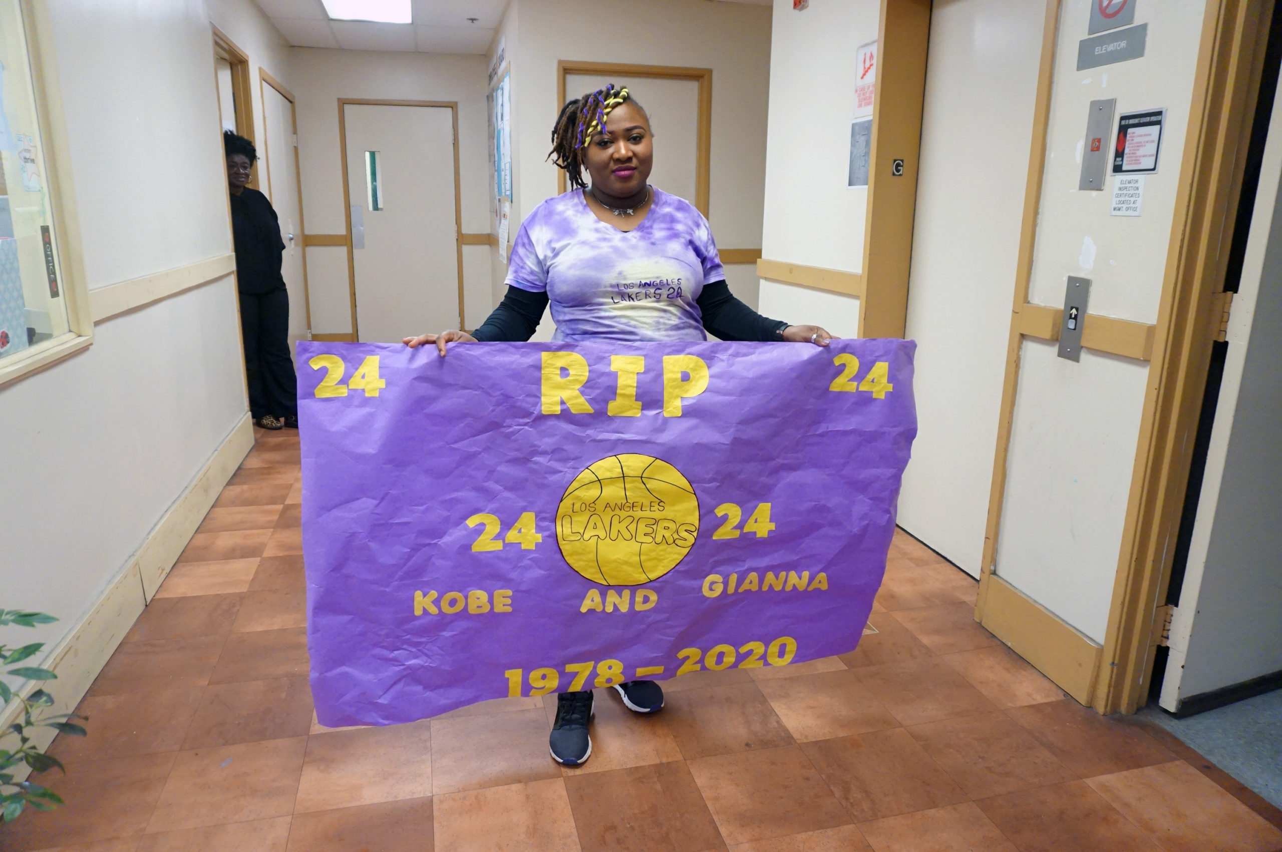 HHELC-Kobe-Bryant-Remembrance-Ms.-Nikki-with-Sign