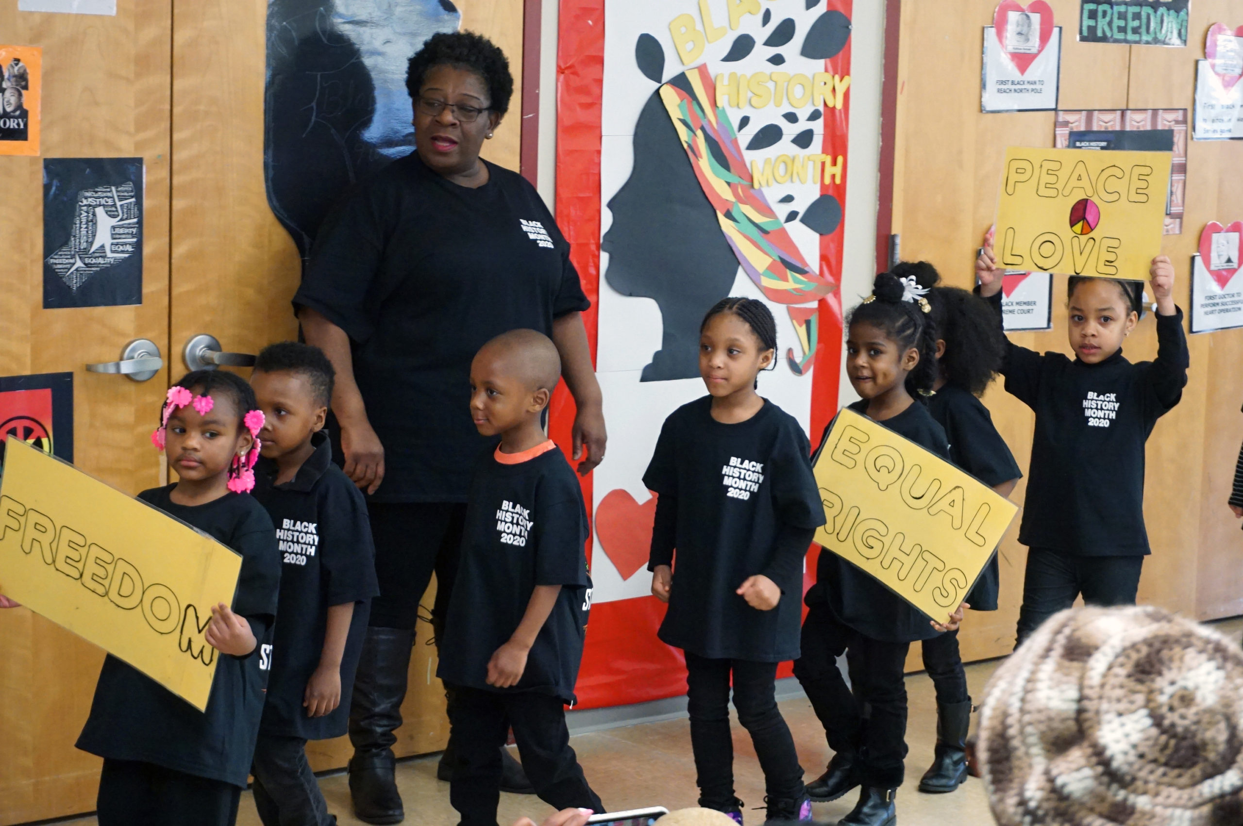 CHELC Black History Month Celebration Class with Shirts and Signs