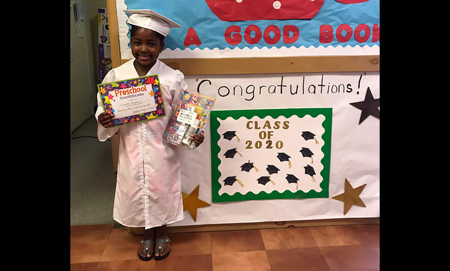 HHELC Graduation 2020 Girl with Certificate and Supplies Black Background