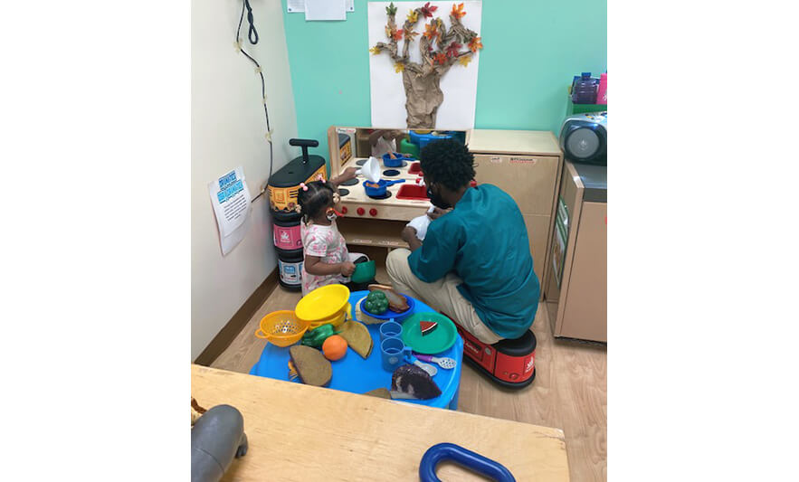 CHELC Opening 2020 Child Playing with Teacher in Kitchen for Website