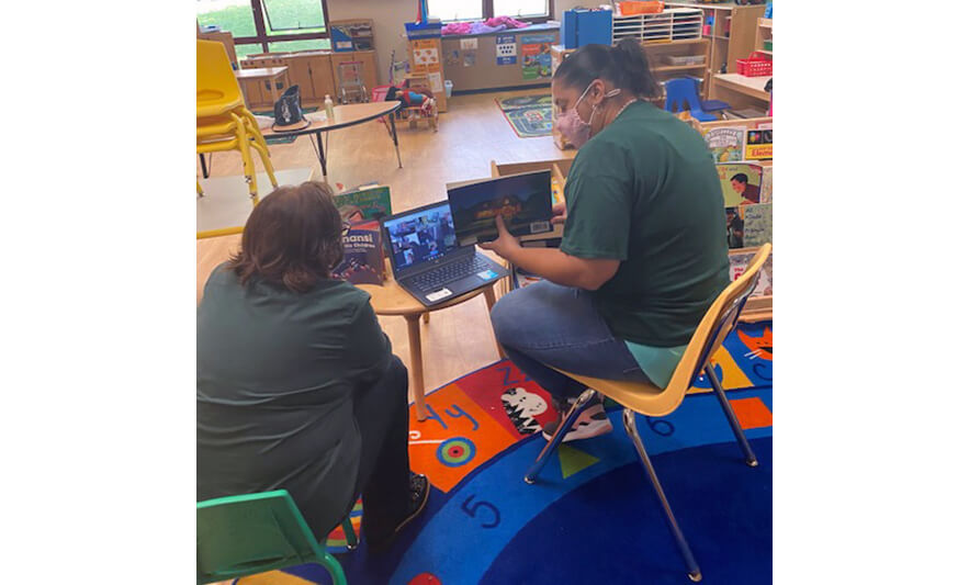 CHELC Opening 2020 Teachers Reading to Virtual Class on Laptop for Website