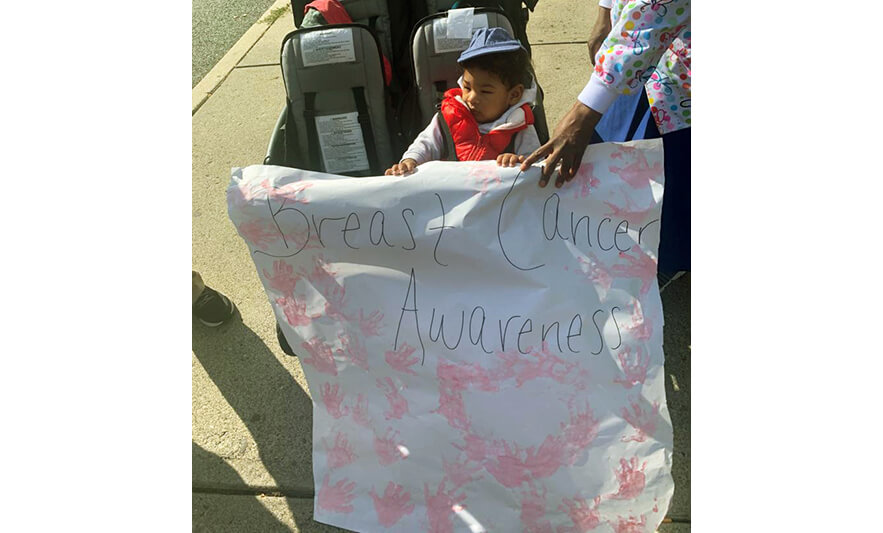 HHELC Breast Cancer Awareness March 2020 Infant with Sign for Website